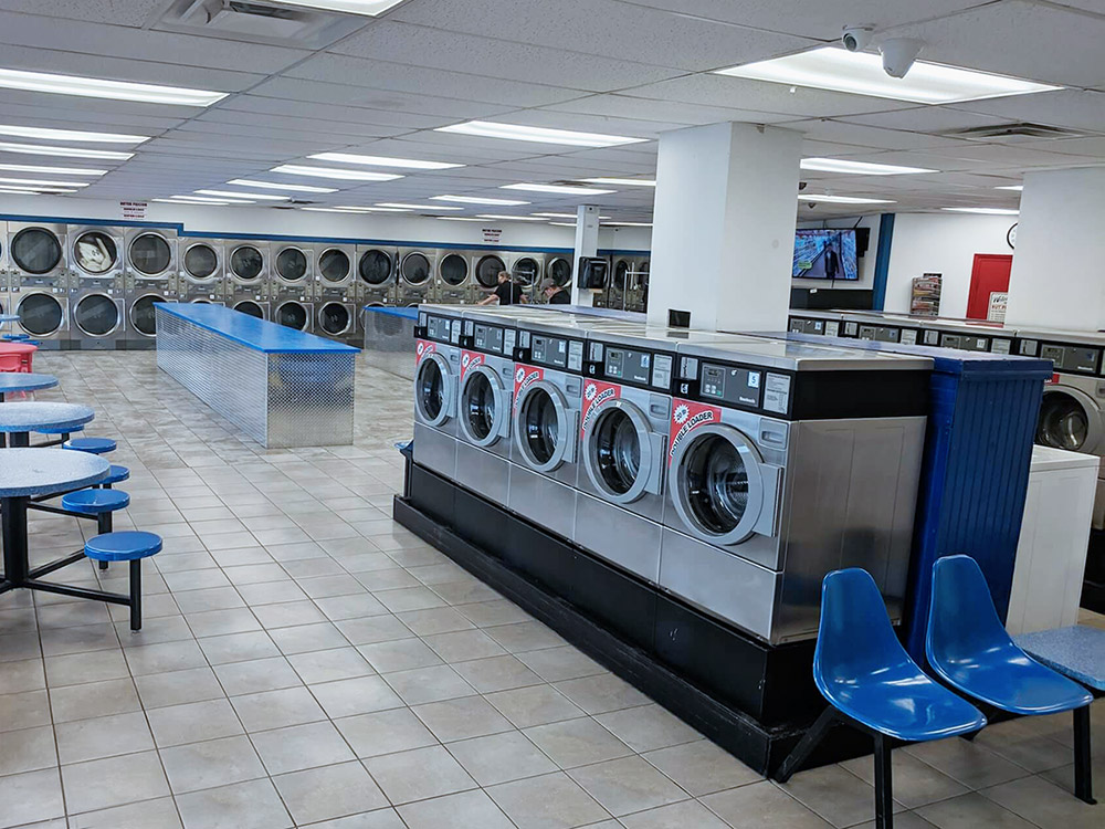 Coin op laundry machines in a laundromat | Coin laundromat near me